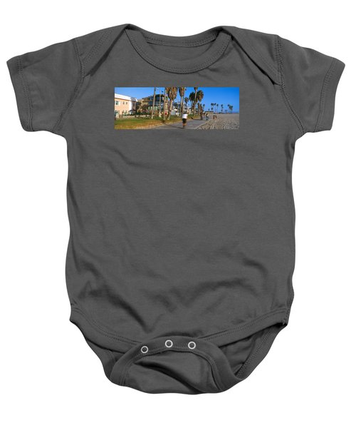 People Riding Bicycles Near A Beach Baby Onesie by Panoramic Images