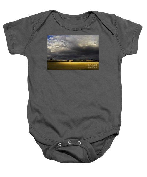 Baby Onesie featuring the photograph Rapefield Under Dark Sky by Heiko Koehrer-Wagner