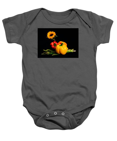 Still Life Peppers Asparagus Sunflower Baby Onesie by Jon Woodhams