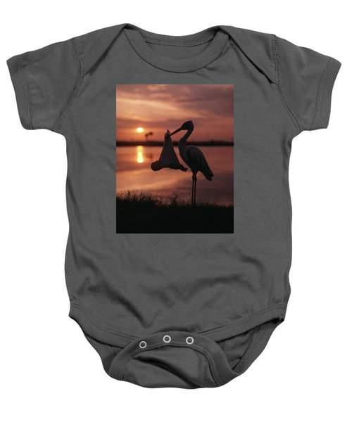 Sunrise Silhouette Of Stork Carrying Baby Onesie