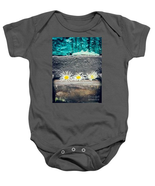 Baby Onesie featuring the photograph Three Daisies Stuck In A Door by Silvia Ganora