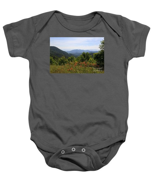 Wild Lilies With A Mountain View Baby Onesie