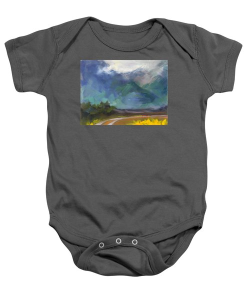 At The Feet Of Giants Baby Onesie