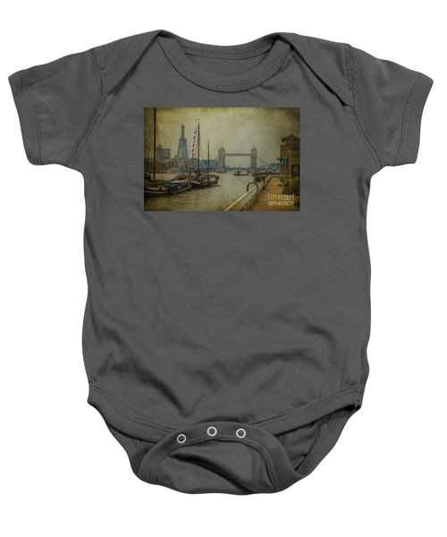 Baby Onesie featuring the photograph Moored Thames Barges. by Clare Bambers