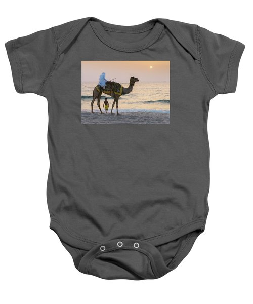 Little Boy Stares In Amazement At A Camel Riding On Marina Beach In Dubai, United Arab Emirates -  Baby Onesie