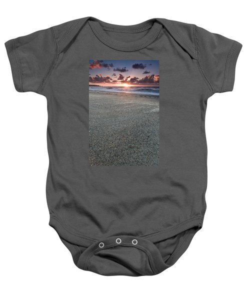 A Beach During Sunset With Glowing Sky Baby Onesie