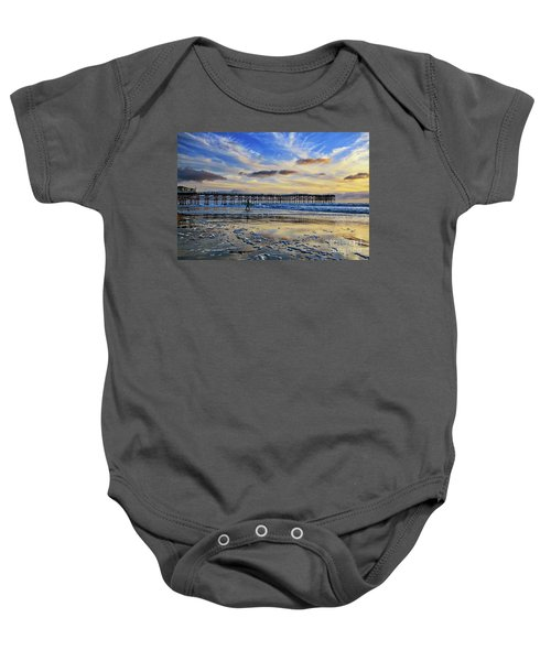 A Surfer Heads Home Under A Cloudy Sunset At Crystal Pier Baby Onesie