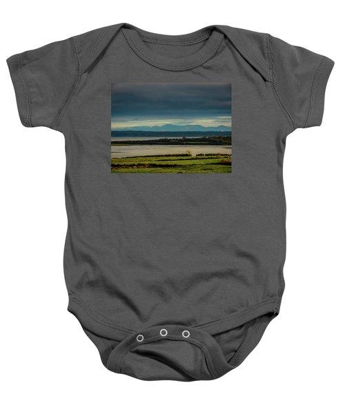 Baby Onesie featuring the photograph Dark Skies Over Ireland's Shannon Estuary by James Truett