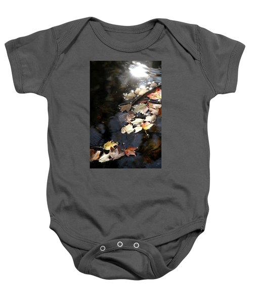 Dry Leaves Floating On The Surface Of A Stream Baby Onesie