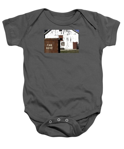 Baby Onesie featuring the photograph Fire Hose by Lora Lee Chapman