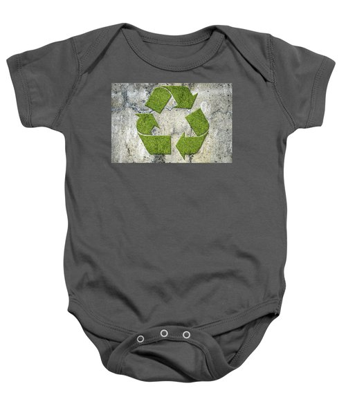Green Recycling Sign On A Concrete Wall Baby Onesie by GoodMood Art