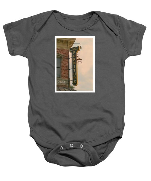 Juan's Furniture Store Baby Onesie by Robert Youmans