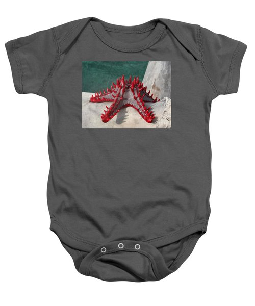 Lone Red Starfish On A Wooden Dhow 3 Baby Onesie