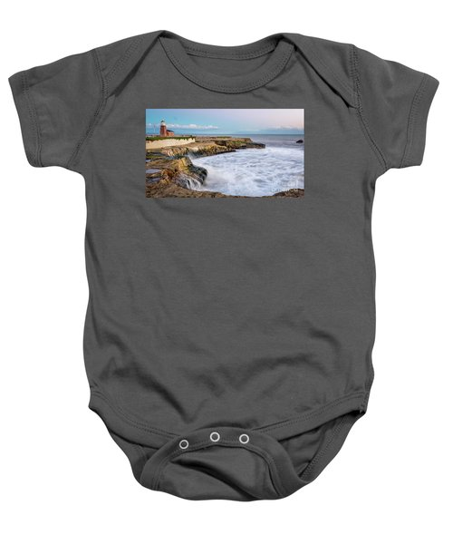 Long Exposure Of Waves Against The Cliff With Lighthouse In Shot Baby Onesie