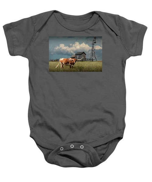 Longhorn Steer In A Prairie Pasture By Windmill And Old Gray Wooden Barn Baby Onesie