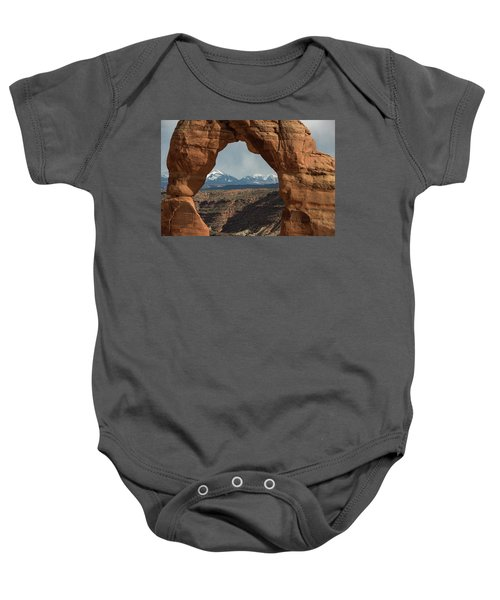Baby Onesie featuring the photograph Looking Through Delicate Arch by Jennifer Ancker