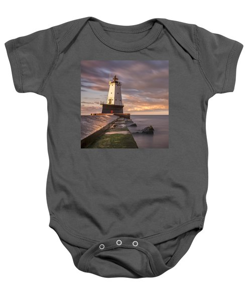 Baby Onesie featuring the photograph Ludington North Breakwater Light At Dawn by Adam Romanowicz
