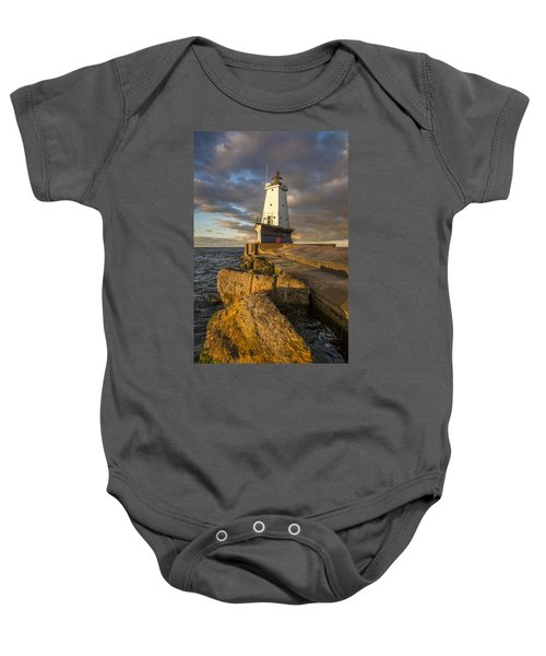Baby Onesie featuring the photograph Ludington North Breakwater Lighthouse At Sunrise by Adam Romanowicz