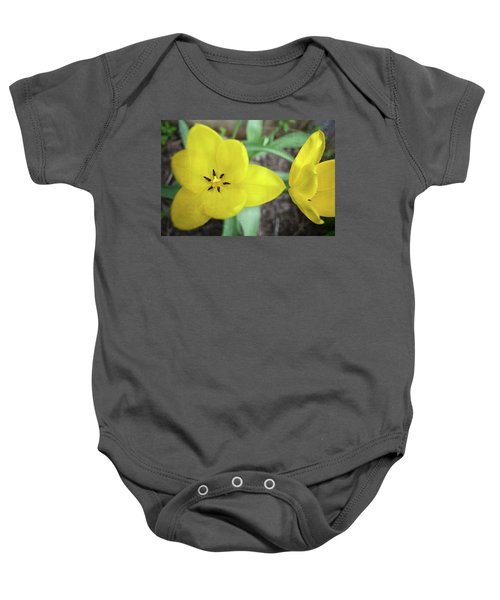 Baby Onesie featuring the photograph One And A Half Yellow Tulips by Michelle Calkins