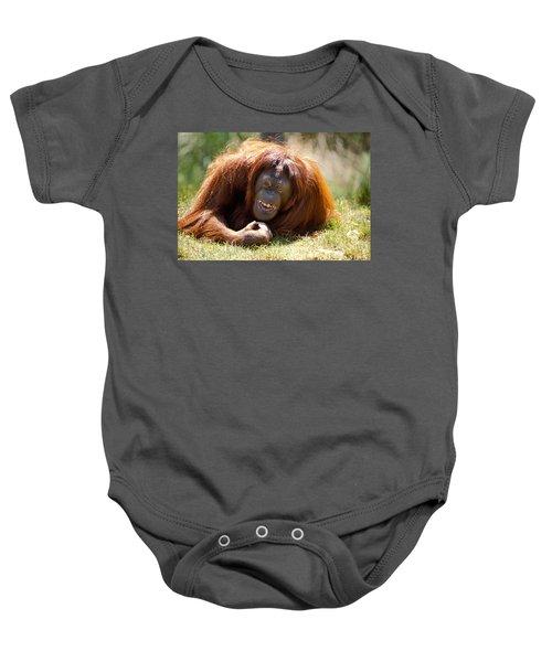 Orangutan In The Grass Baby Onesie by Garry Gay