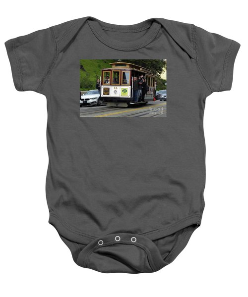 Passenger Waves From A Cable Car Baby Onesie