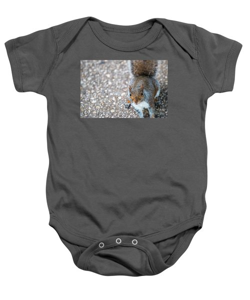 Photo Of Squirel Looking Up From The Ground Baby Onesie