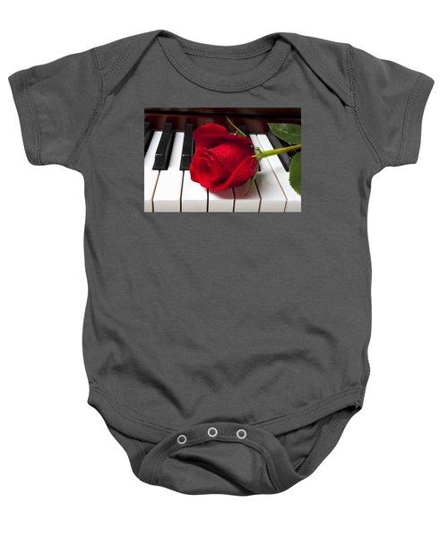 Red Rose On Piano Keys Baby Onesie