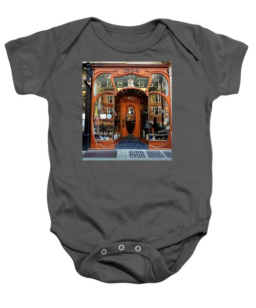 Reflecting On A Cambridge Shoe Shine Baby Onesie