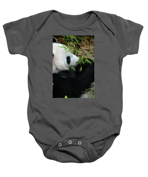 Relaxed Panda Bear Eats With Green Leaves In Mouth Baby Onesie