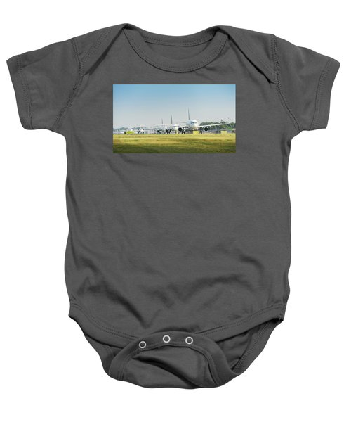 Row Of Airplanes Ready To Take-off Baby Onesie