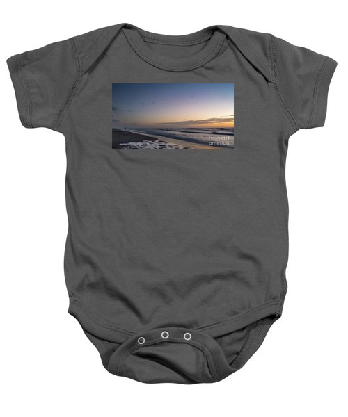 Single Man Walking On Beach With Sunset In The Background Baby Onesie