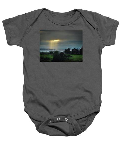 Baby Onesie featuring the photograph Sunbeam Spotlights Shannon Airport by James Truett