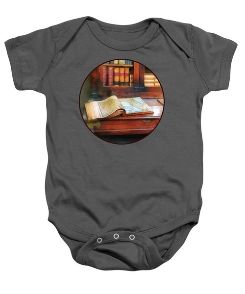 Teacher - Geography Book Baby Onesie