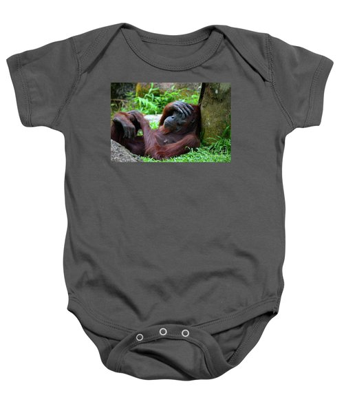 Tired Female Orangutan Ape Rests Against Tree With Hand On Her Head Baby Onesie