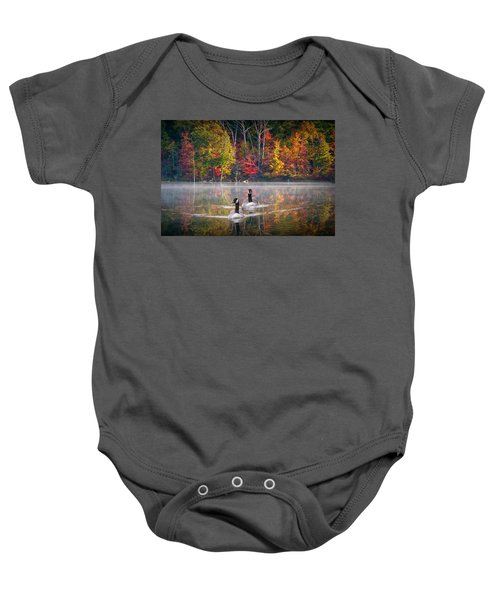 Two Canadian Geese Swimming In Autumn Baby Onesie