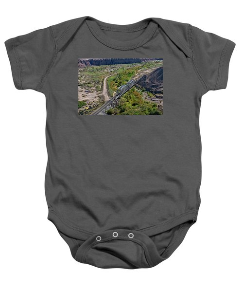 Baby Onesie featuring the photograph Up Tracks Cross The Mojave River by Jim Thompson