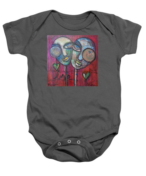 We Live With Love In Our Hearts Baby Onesie