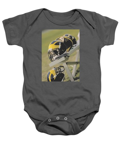 Wolverine Helmets On A Football Bench Baby Onesie