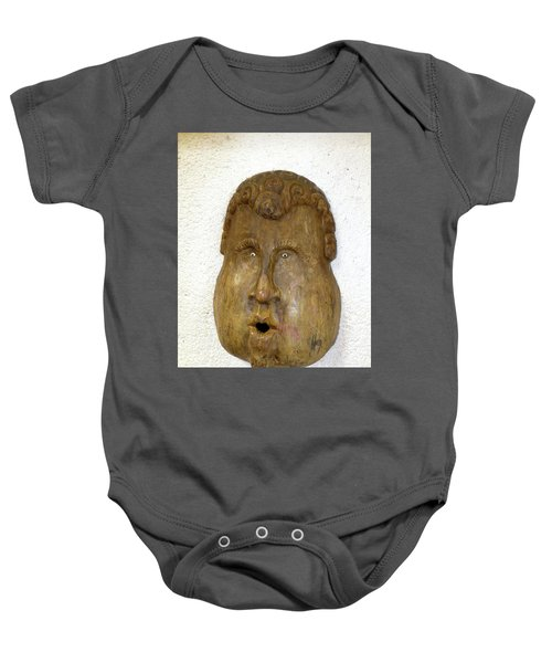 Baby Onesie featuring the photograph Wood Carved Face by Francesca Mackenney