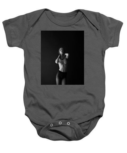 Young Woman In Pantyhose In Front Of Black Wall Baby Onesie