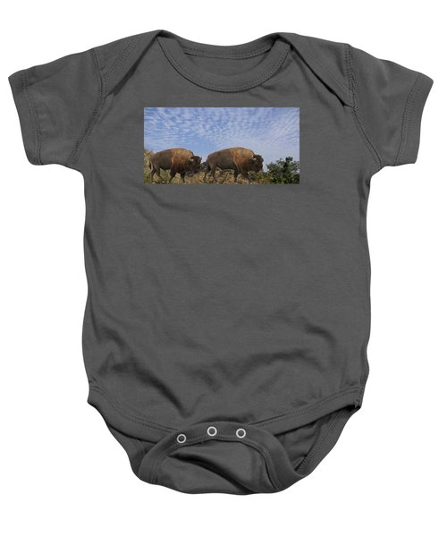 Group Of Bison Walking Against Rocky Mountains  Baby Onesie