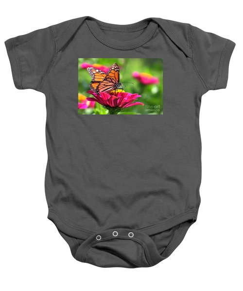 Monarch Visiting Zinnia Baby Onesie
