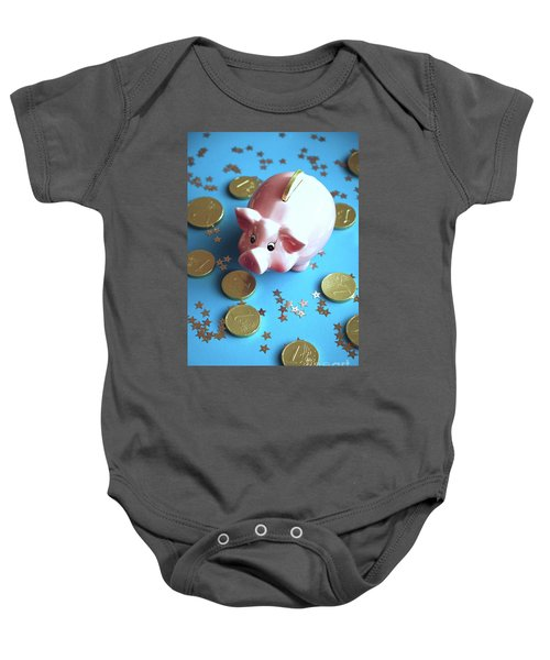 Piggy Bank On The Background With The  Chocoladen Coins Baby Onesie