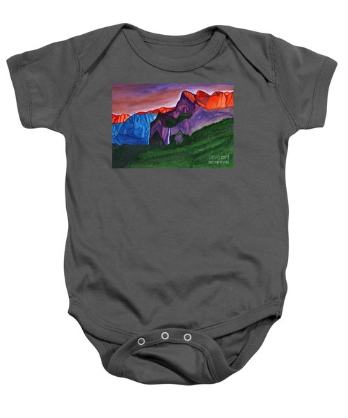 Snowy Peaks Of The Mountains With A Waterfall Lit Up By The Orange Dawn Baby Onesie