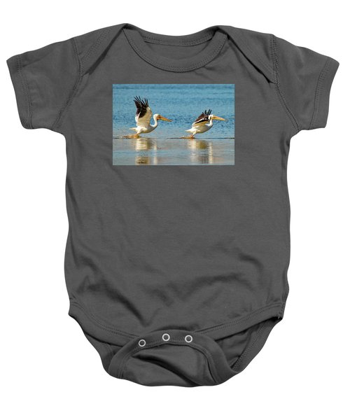Two Pelicans Taking Off Baby Onesie