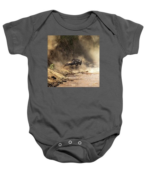 Wildebeest Leaps From The Bank Of The Mara River Baby Onesie