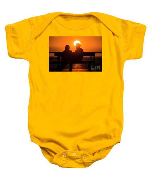 A Couple Sitting At Sunset Baby Onesie