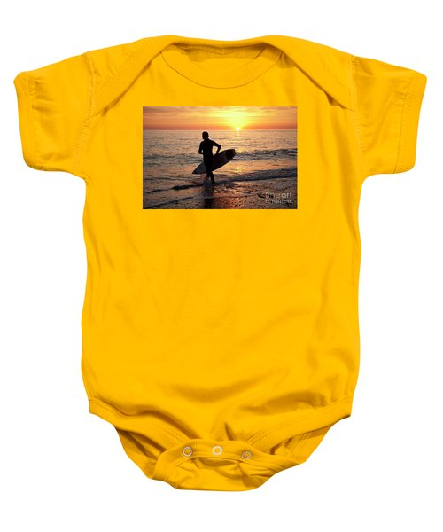 A Young Man Surfing At Sunset Off Aberystwyth Beach, Wales Uk Baby Onesie