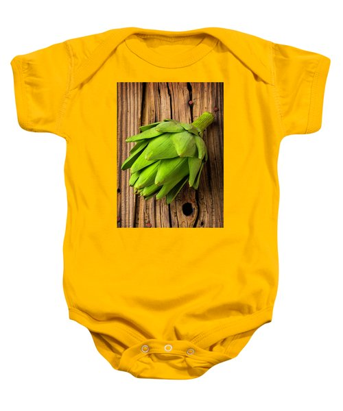 Artichoke On Old Wooden Board Baby Onesie by Garry Gay