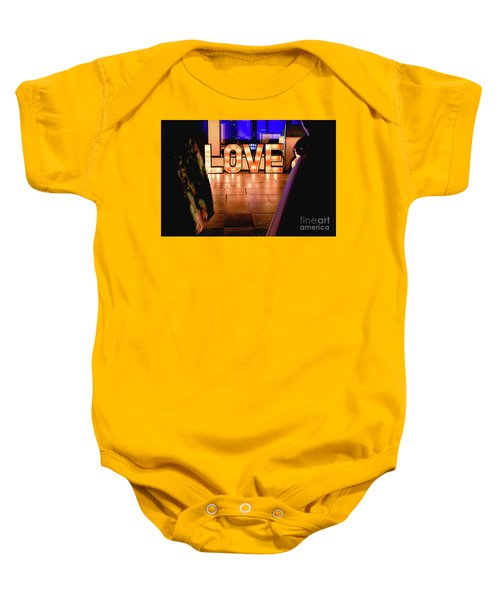Bright Wooden Letters With Word Love In A Party Baby Onesie